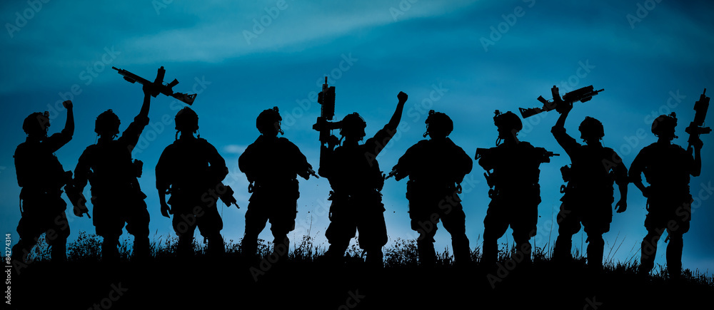 Fototapeta Silhouette of military team soldiers or officers with weapons
