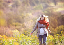 Beautiful Pregnant Woman Outside In Autumn Nature