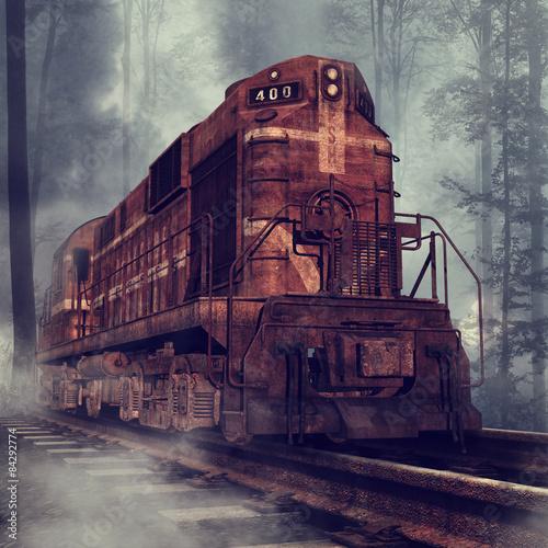 Obrazy na płótnie Canvas Stary zardzewiały pociąg na torach w lesie