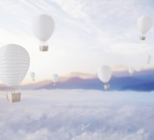 Defocused Balloons Over Dreamy Sky