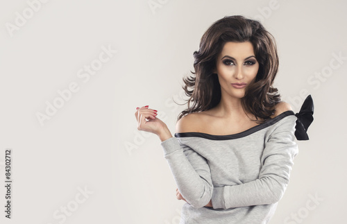 Obraz Young beautiful brunette in a sexy dress - fototapety do salonu