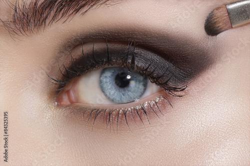 Foto op Plexiglas Beauty Close up on eyes , making colorful eyeshadows and eyeliner