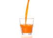 Juice pouring into glass isolated on white