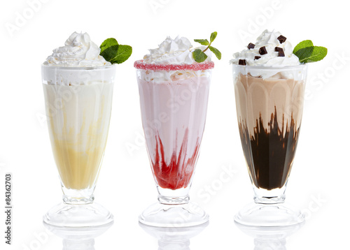 Three glasses of milkshakes, bananashake, chocolateshake and fruiteshake cocktails