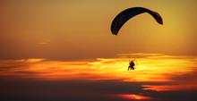 Man Enjoying Paraglide On Sky