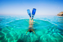 Diving. Women Snorkeling In Flippers Beach Islands. Girl Dives