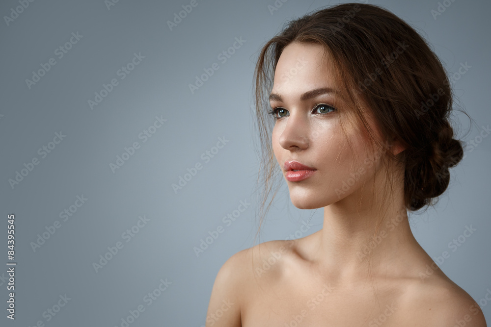 Fototapeta Beautiful woman with natural make up and hairstyle