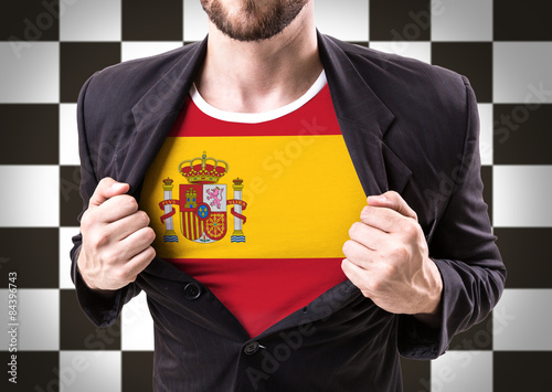Businessman stretching suit with Spain flag on checkered Poster