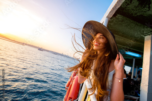 Woman enjoying the sea from ferry boat Wallpaper Mural