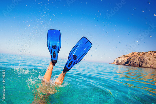 Photo Flippers in water. Diver fins. Active vacation at sea. Diving.