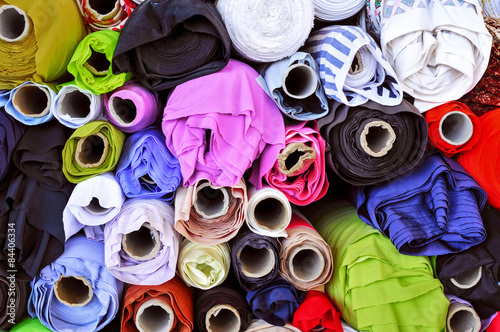 fabric on sale in a street market Canvas Print