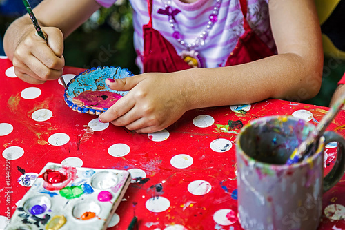 Children painting pottery 13