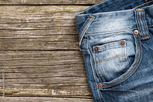 Obraz na płótnie Jeans on wooden background