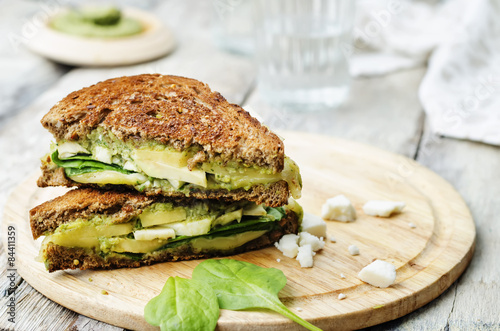 Staande foto Snack grilled rye sandwiches with cheese, spinach, pesto, avocado and
