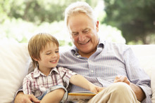 Grandfather With Grandson Read...