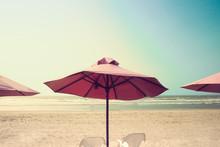 Retro Beach With Pink Umbrellas