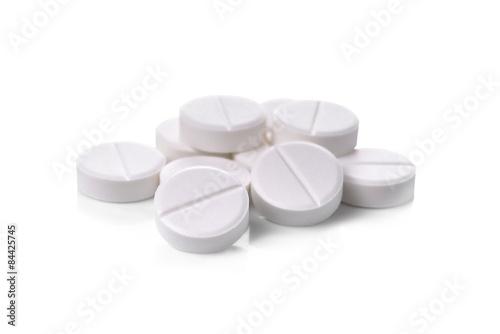 Fotografia  white pills on white background