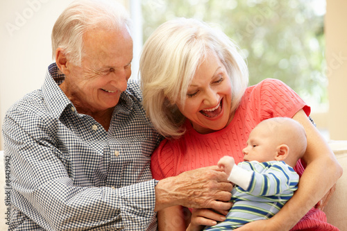 Obraz Senior couple with baby grandson - fototapety do salonu