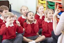 Pupils Copying Teacher's Actio...