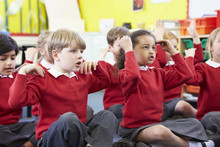 Pupils Perfoming Actions Whils...