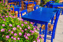Blue Tables In Colorful Greek Restaurant, Greece