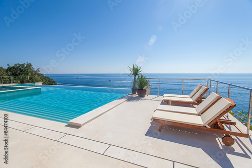 Luxury swimming pool and blue water Wallpaper Mural