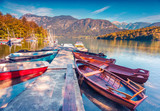 Colorful summer morning on the Bohinj Lake with boats