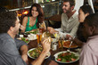 canvas print picture - Group Of Friends Enjoying Evening Meal In Restaurant