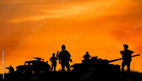 Silhouette of military sold...