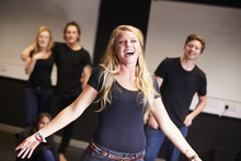 Students Taking Singing Class At Drama College