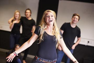 Fototapeta Students Taking Singing Class At Drama College
