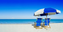 Sun Loungers And A Beach Umbrella On Silver Sand,  Vacation Conc