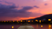 Colorful Bokeh Of City From The Sea In Night Time And Wooden