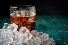 Glass Of Cola With Ice On A Wo...