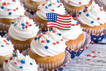 Patriotic Cupcakes With Sprinkles And American Flag