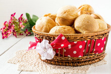 A Basket Of Fresh Homemade Popover And Flowers