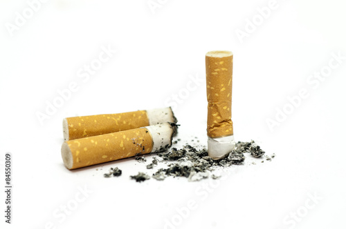 Fotografija  Group of finished cigarettes isolated on white