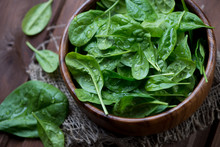Wooden Bowl With Fresh Spinach...