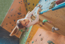 Happy Little Girl Climbing Ind...