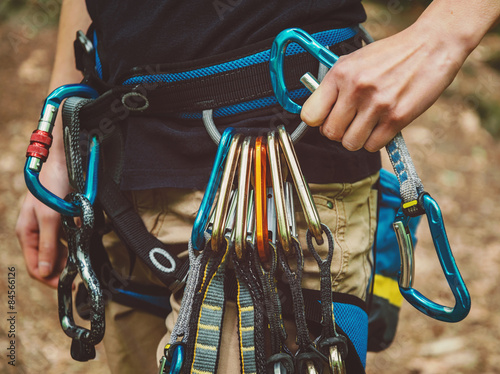 Photo sur Aluminium Alpinisme Female rock climber wearing safety harness