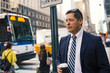 Businessman having a rest with a cup of coffee in Manhattan on t