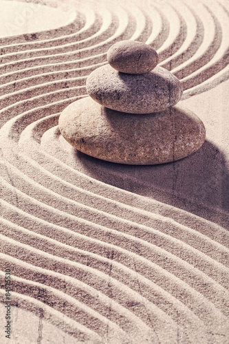 zen still life for spa and massage with sand and stones for balance and meditation with textured and contrast effects