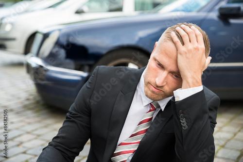 Obraz na plátně Sad Young Man With Damaged Car