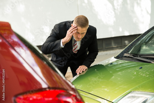 Fototapeta  Stressed Driver Looking At Car After Traffic Collision