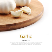 Garlic On Wooden Cutting Board, Isolated On White Background