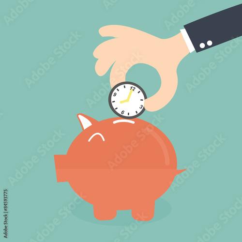 Fotografía  Time Saving Into Piggy Bank