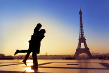 Young Couple In Love At Eiffel Tower