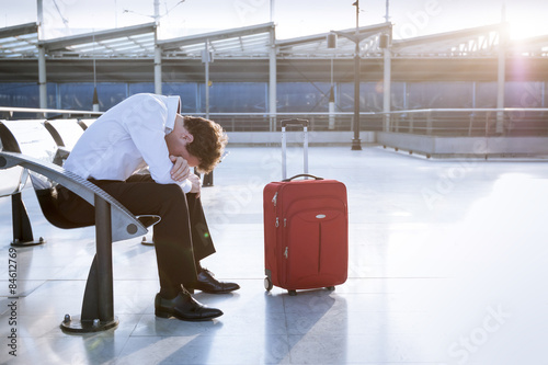Fotografie, Obraz  Businessman in working on laptop in airport waiting lounge