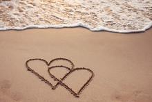 Honeymoon, Two Hearts Drawn On Sand Beach