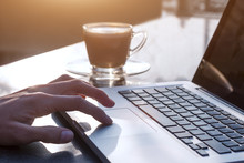 Woman Using Laptop Computer With Coffee